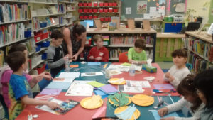 Children doing arts and crafts at the library
